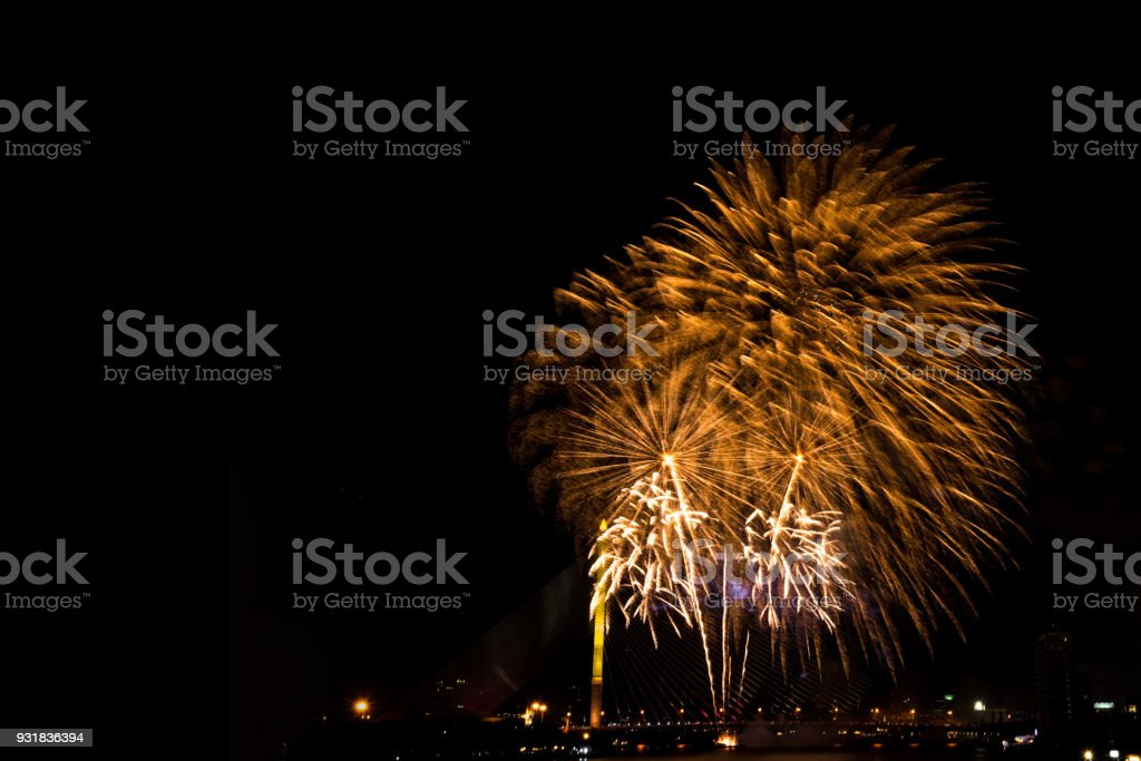 Beautiful golden firework display for celebration happy new year and merry christmas in the night sky, bangkok city, thailand stock photo