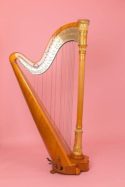 beautiful golden harp - harpist stock photos and pictures