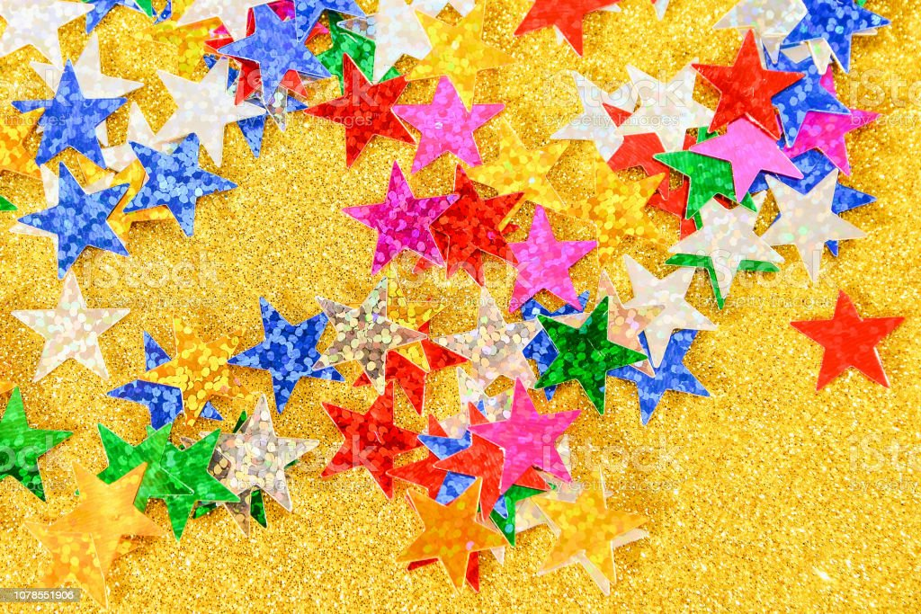 Beautiful golden holiday background. Shiny with stars abstract for...