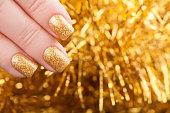 Beautiful golden manicure.