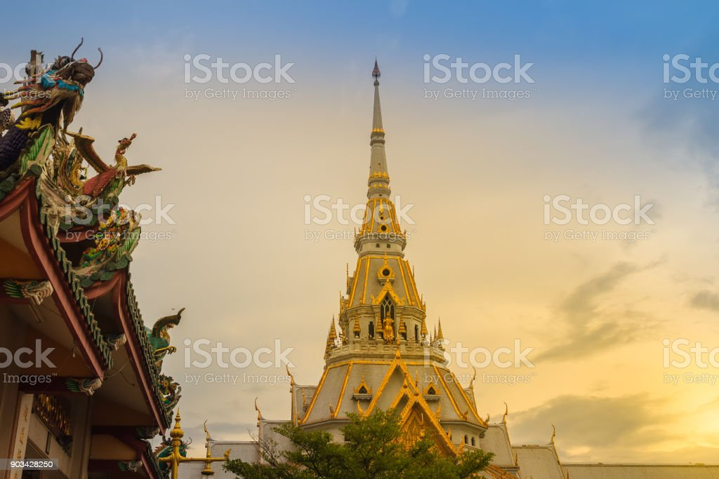 Beautiful golden pagoda at Wat Sothonwararam, a famous public temple in Chachoengsao Province, Thailand. stock photo