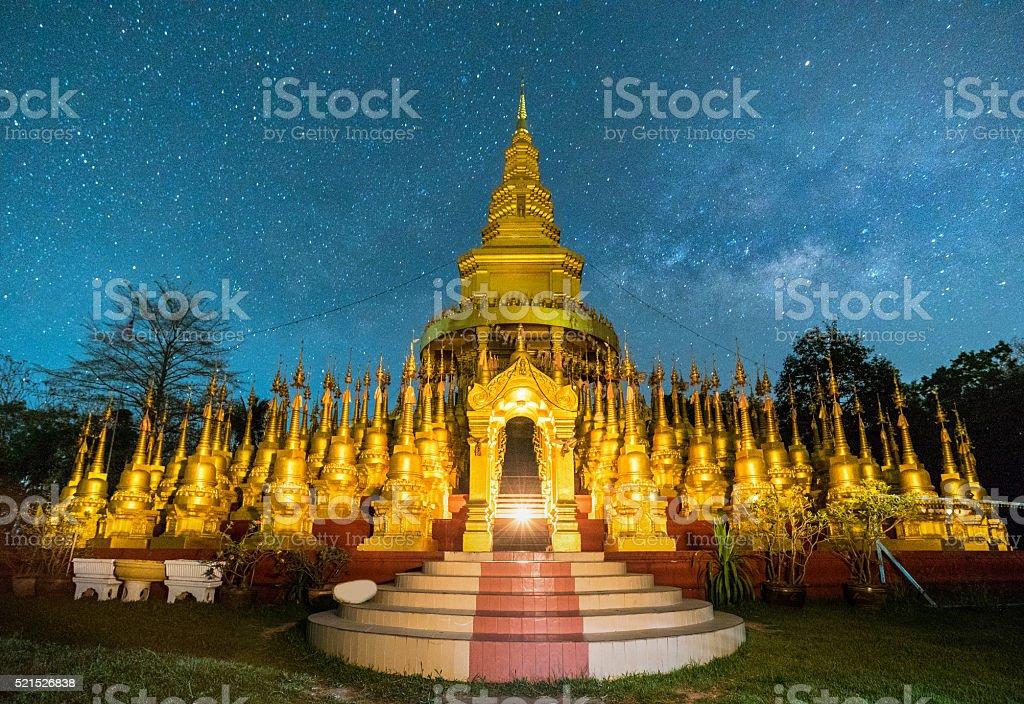 Beautiful golden pagoda of Pa sawangboon temple with milky way stock photo