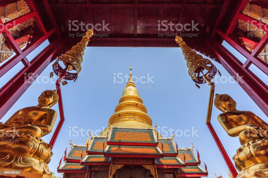 Beautiful Golden Pagoda with Couple Gold Buddha Statues - Royalty-free Ancient Stock Photo