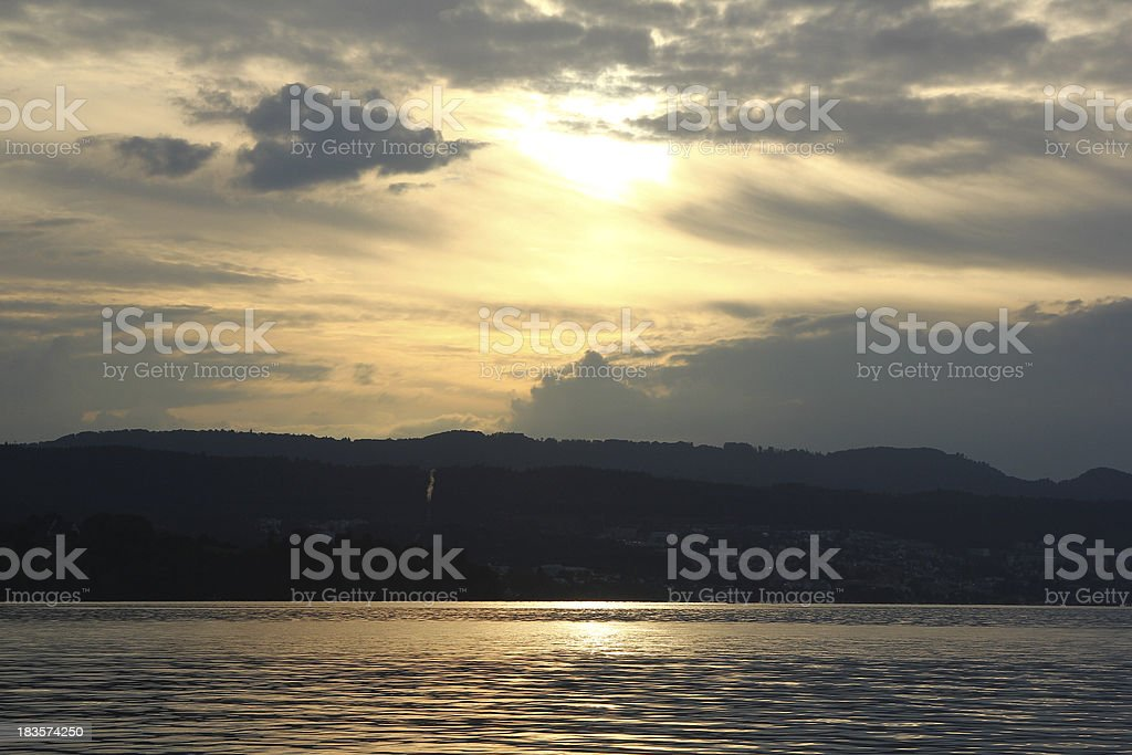 Beautiful golden sunset on the lake of Zurich in Switzerland royalty-free stock photo