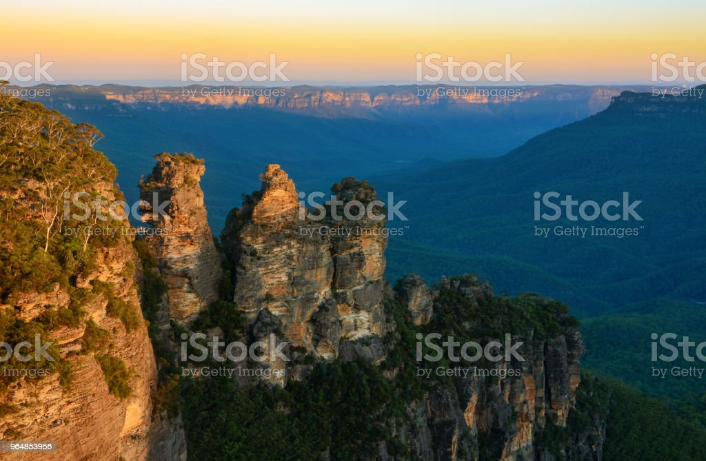 Beautiful golden sunset over the Three Sisters rock formation in the Blue Mountains of NSW, Australia stock photo