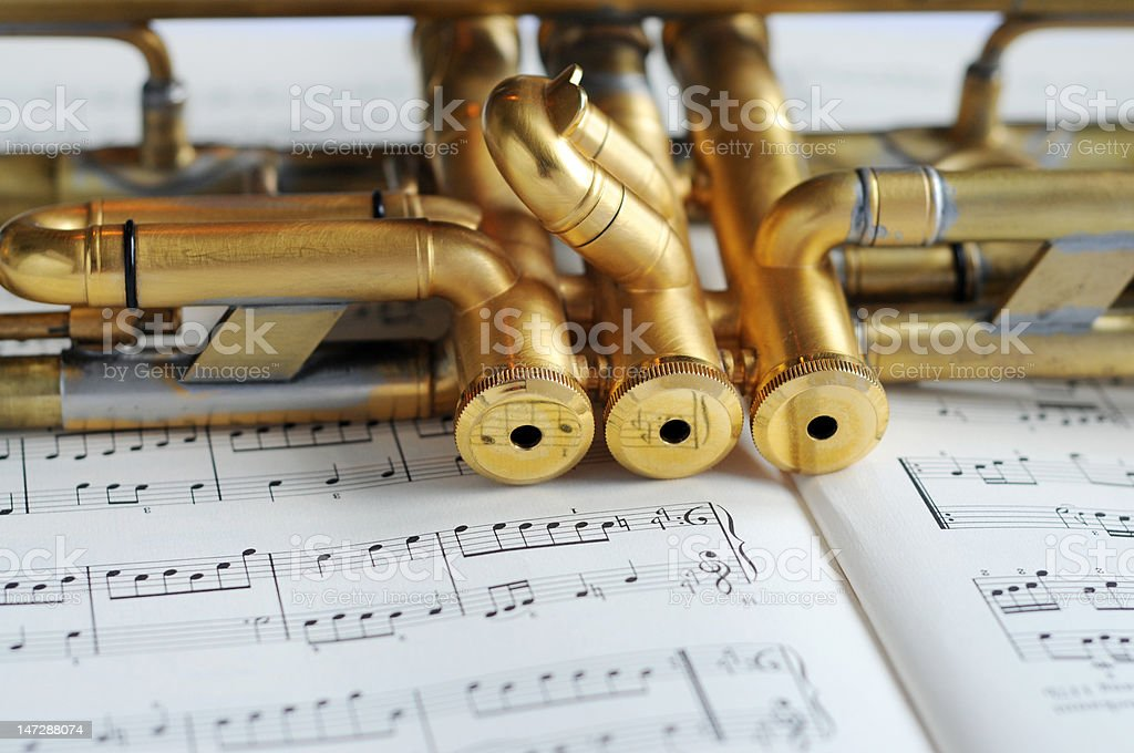beautiful golden trumpet on sheet music royalty-free stock photo