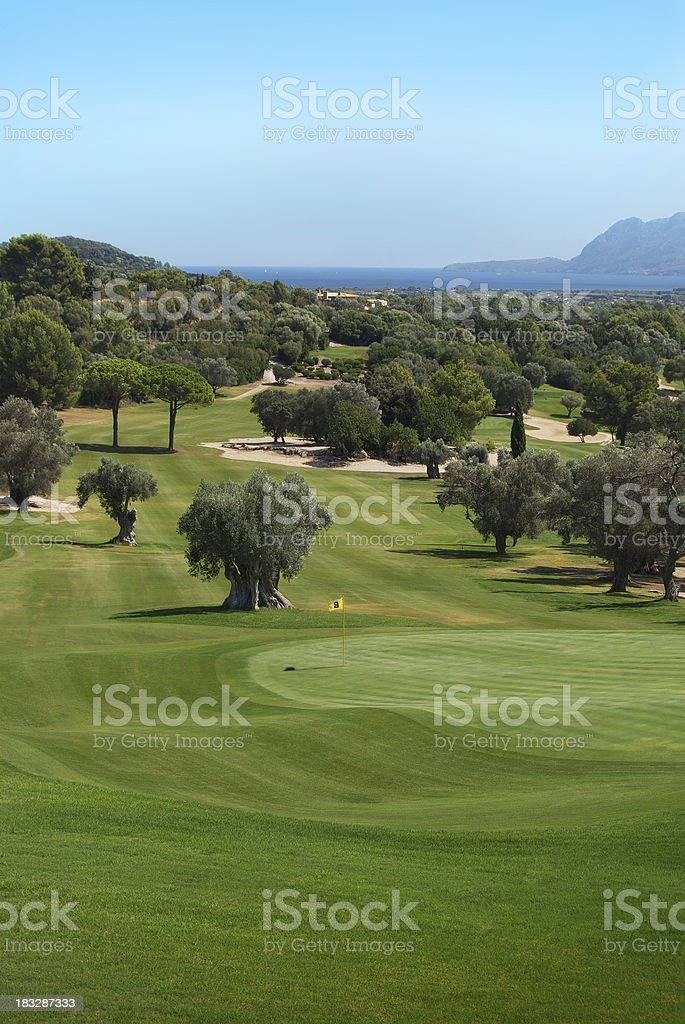 Beautiful Golf Course with ocean in the background stock photo