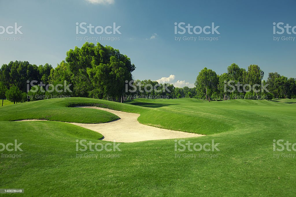 Beautiful golf course with sand trap stock photo