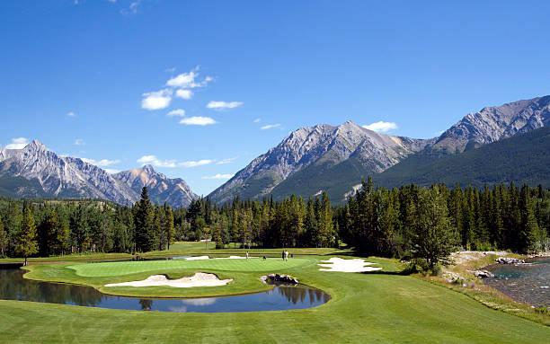 Beautiful Golf Hole Beautiful Par 3 at Mount Kidd Golf Course, Kananaskis Country, Alberta, Canada kananaskis country stock pictures, royalty-free photos & images