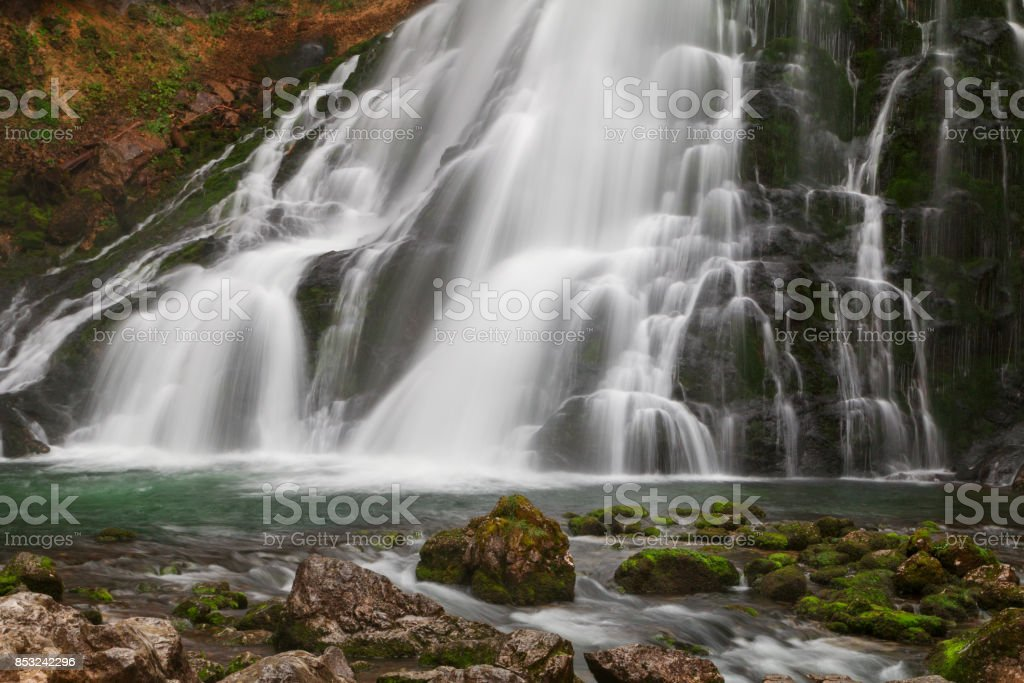 Beautiful Golling waterfall and near Golling and Salzach medieval town at autumn stock photo