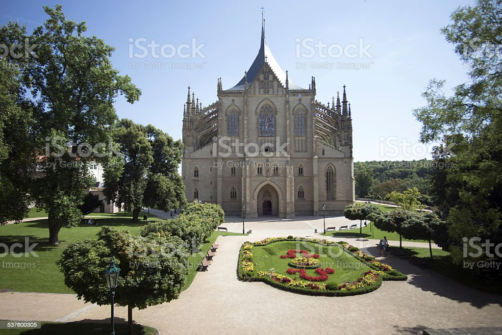 Beautiful Gothic church with flower garden stock photo