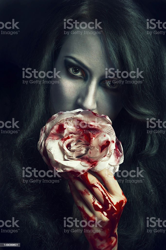 beautiful gothic girl with rose stock photo