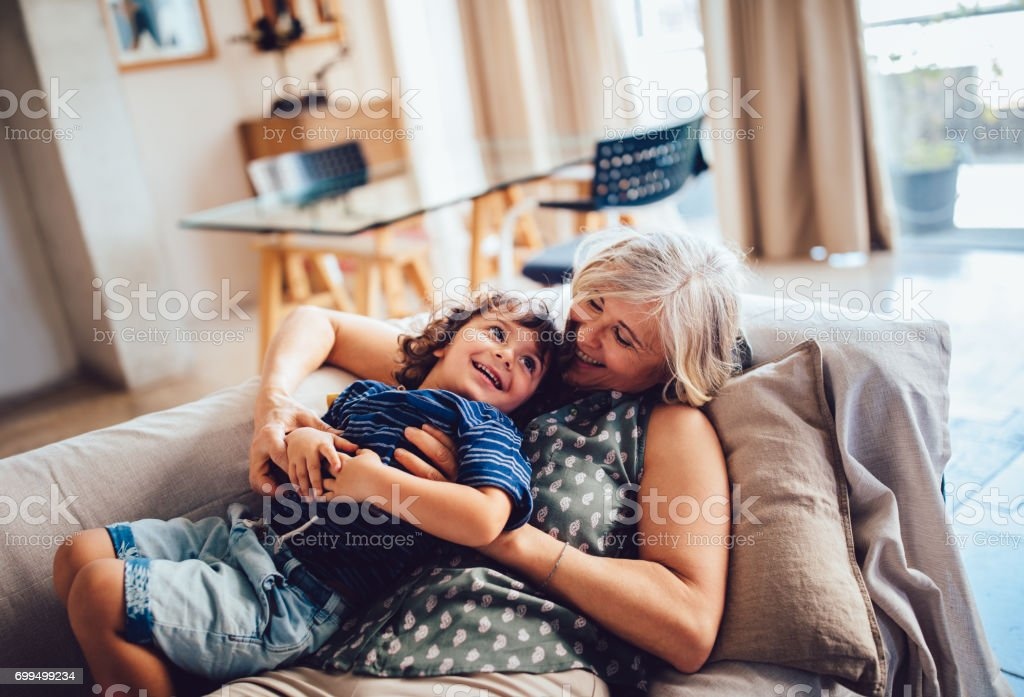 Beautiful grandma and grandson playing together having fun at home – zdjęcie