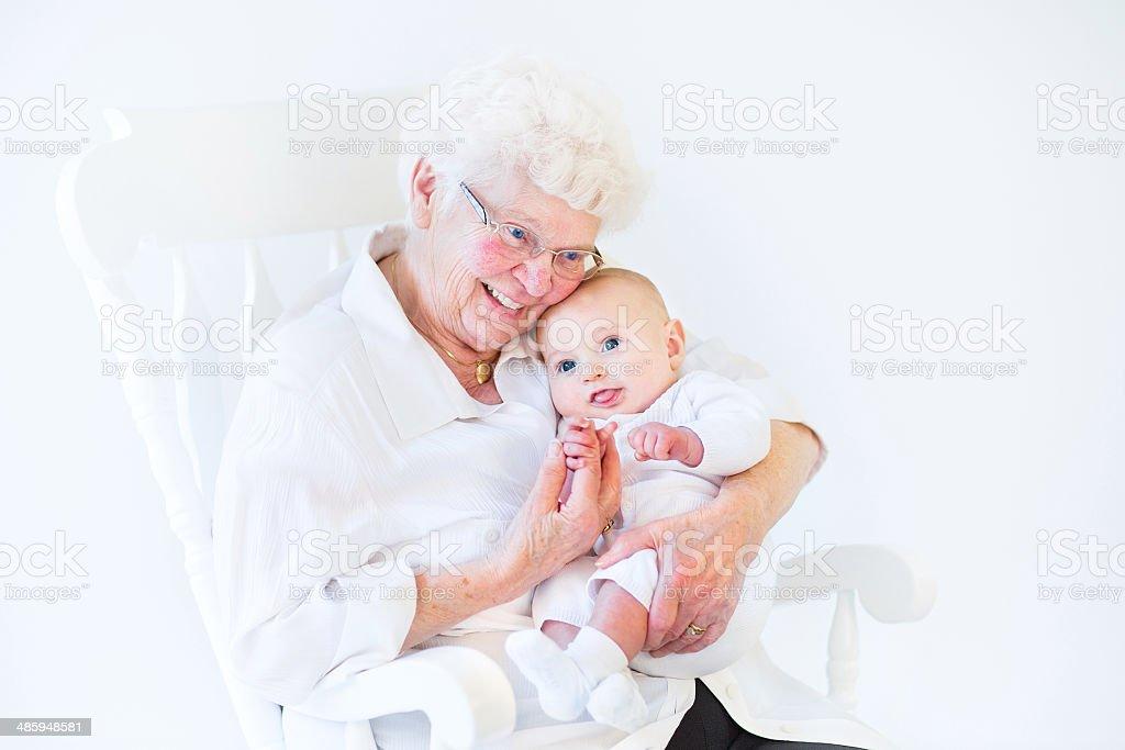 Beautiful grandmother singing to her newborn baby grandson stock photo