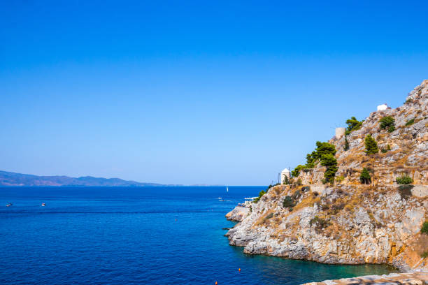 Beautiful Greek landscape of Avlaki beach on Hydra with nobody. Hydra is one of the Saronic Islands of Greece, located in the Aegean Sea between the Saronic Gulf and the Argolic Gulf stock photo