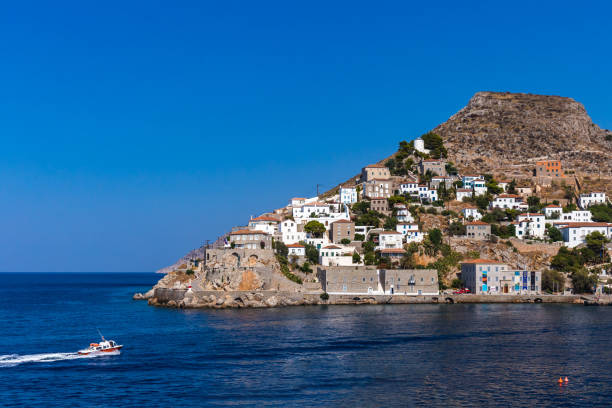 Beautiful Greek landscape of Harbour Hydra Town. Hydra is one of the Saronic Islands of Greece, located in the Aegean Sea between the Saronic Gulf and the Argolic Gulf stock photo
