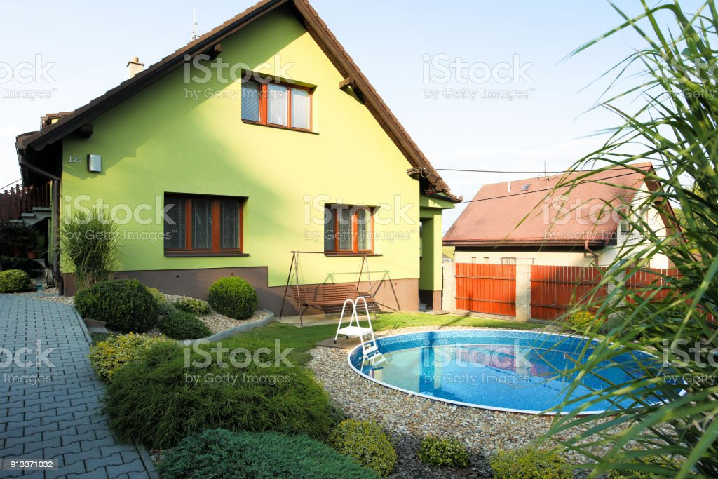 beautiful green colored rural house stock photo