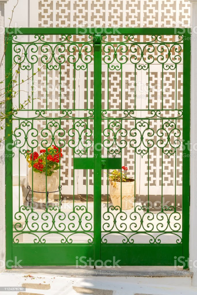 Beautiful green door at Andros island in Greece. Colors of Cyclades in mediterranean. stock photo