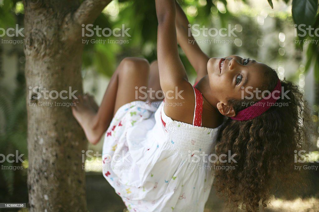 beautiful green eyed girl swinging in tree stock photo