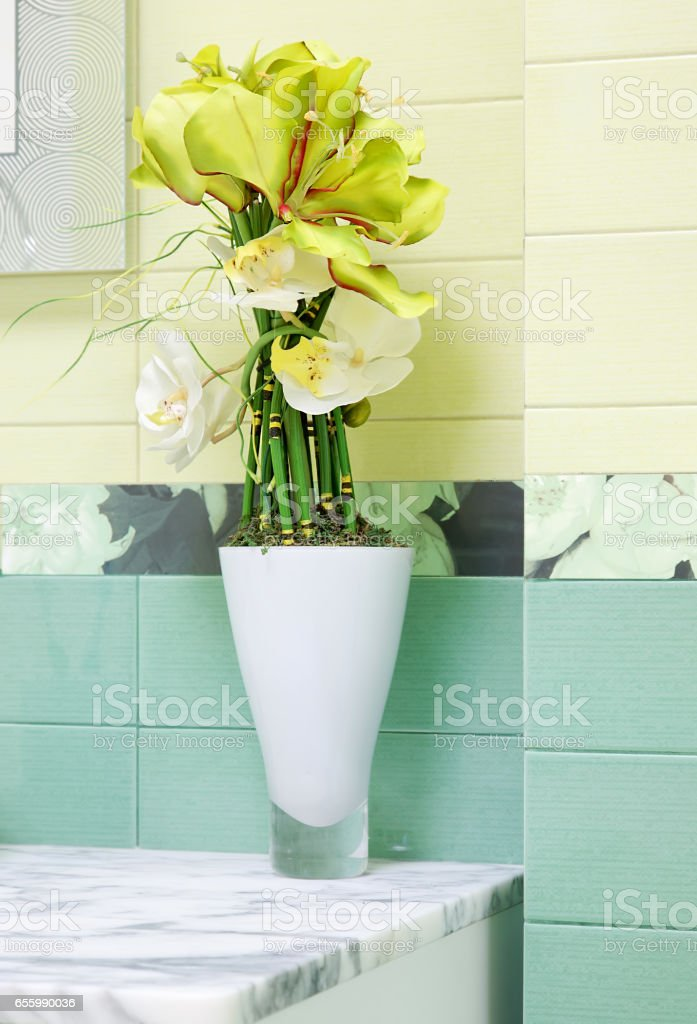 Beautiful green flower decor in bathroon design stock photo