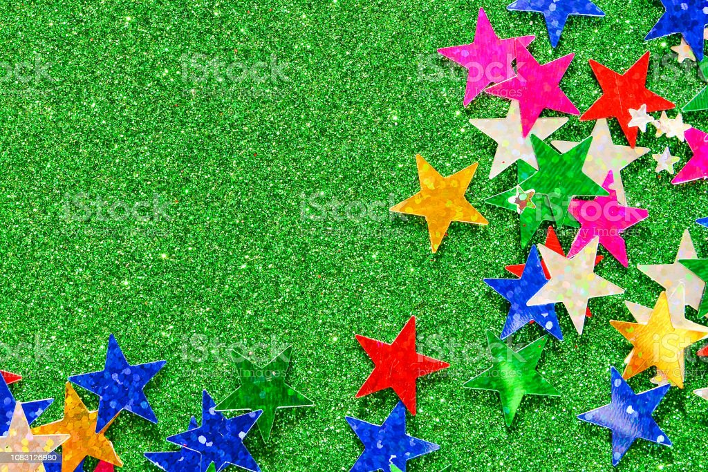 Beautiful green holiday background. Shiny with stars abstract for...