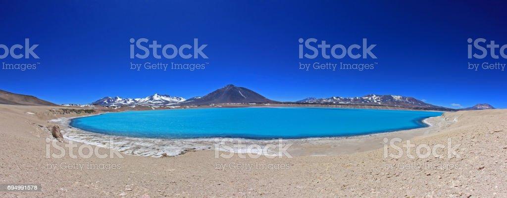 Beautiful Green Lagoon, Laguna Verde, near mountain pass San Francisco and Nevado Ojos Del Salado, Atacama, Chile stock photo