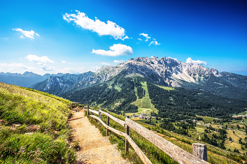 istock Beautiful green meadows with Latemar mountains group ( Latemargruppe), under a sunny blue sky Trentino Alto adige, Italy 812504454