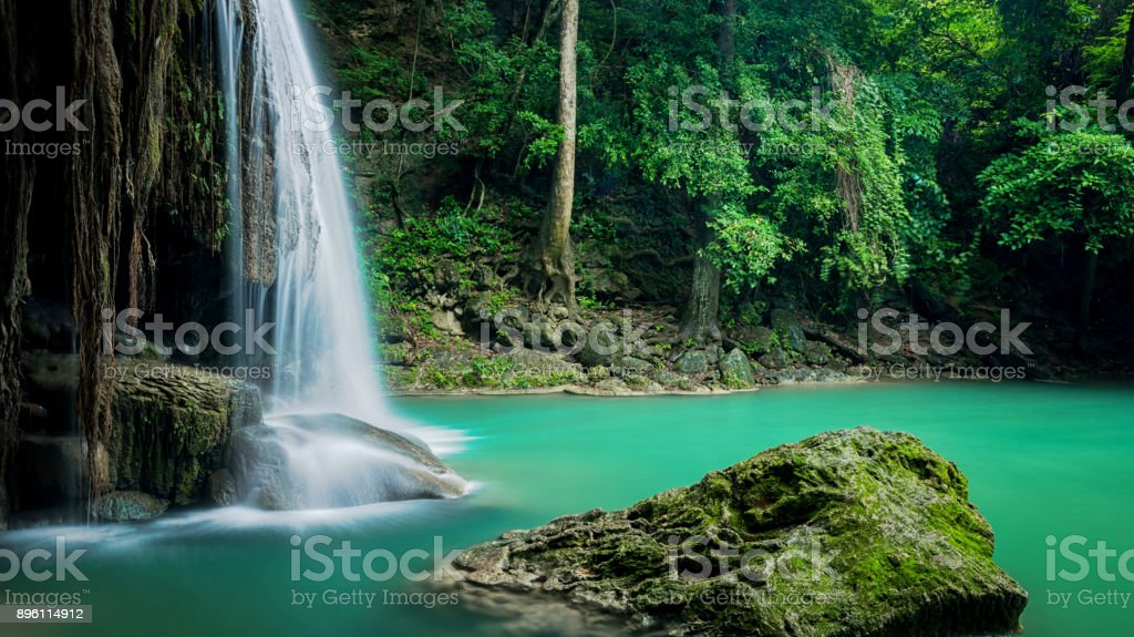 Beautiful green waterfall at deep forest, Erawan waterfall located Kanchanaburi Province, Thailand stock photo