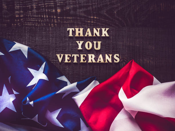 beautiful greeting card on veterans day. top view. - veterans day стоковые фото и изображения
