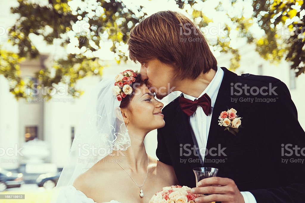 Beautiful groom kissing young bride royalty-free stock photo