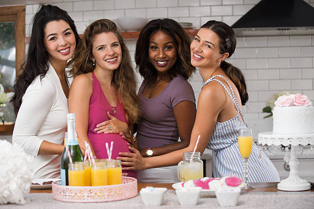 beautiful group friends show support smiling laughing loving celebration pregnancy - mimosa cake foto e immagini stock