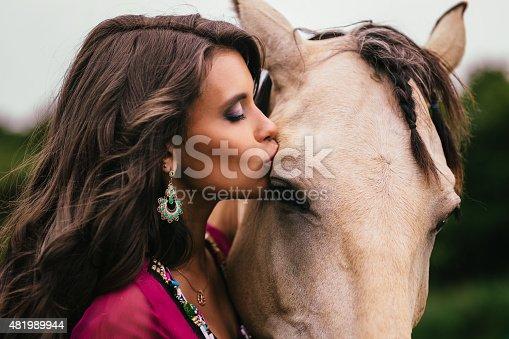 istock Beautiful gypsy in violet dress 481989944