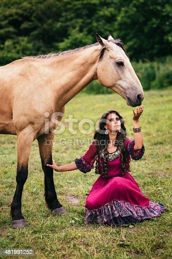 istock Beautiful gypsy in violet dress 481991252