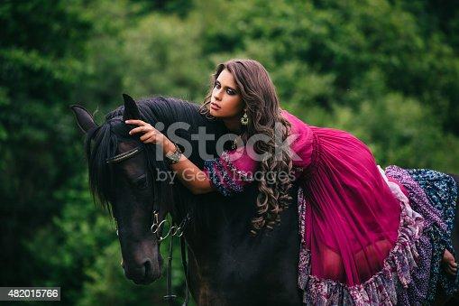 istock Beautiful gypsy in violet dress 482015766