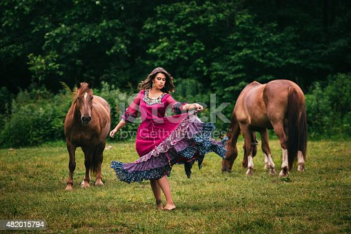 istock Beautiful gypsy in violet dress 482015794