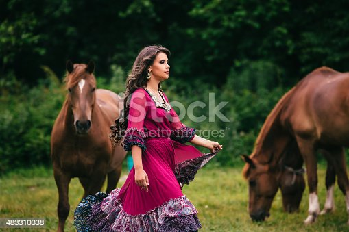 istock Beautiful gypsy in violet dress 483310338
