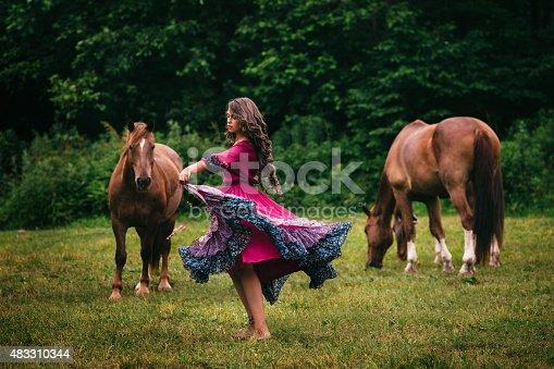 istock Beautiful gypsy in violet dress 483310344
