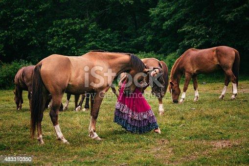istock Beautiful gypsy in violet dress 483310350