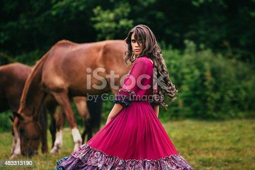 istock Beautiful gypsy in violet dress 483313190