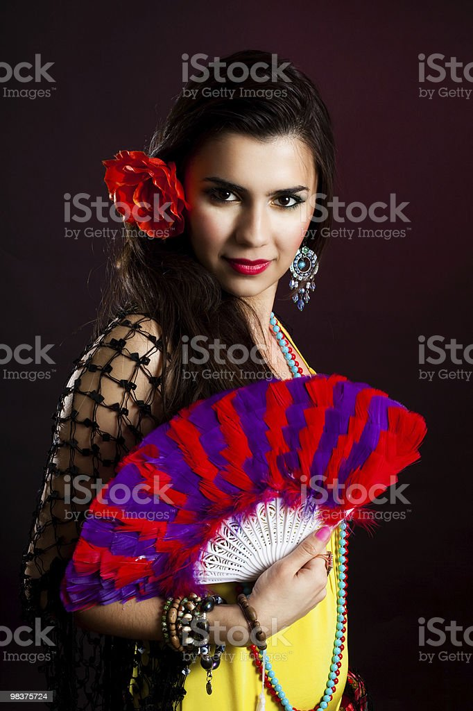 Beautiful gypsy woman with fan royalty-free stock photo