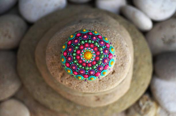 Beautiful hand painted mandala rock stock photo