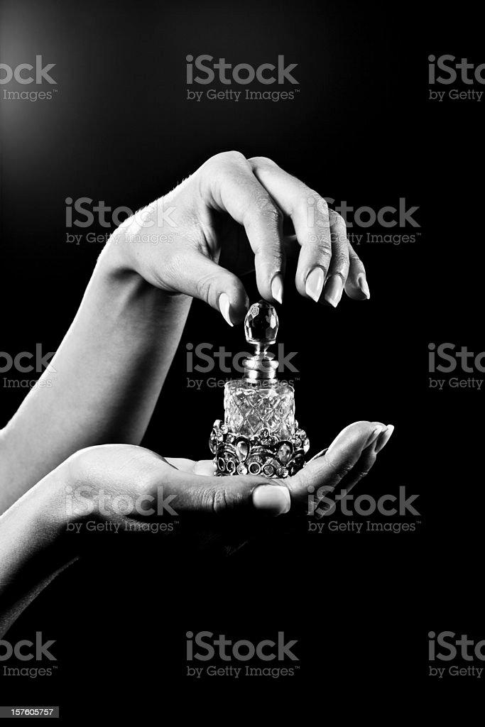 beautiful hands and luxury perfume bottle stock photo