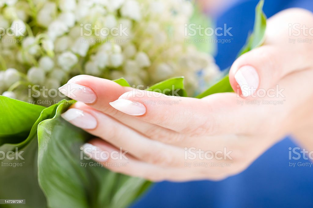 Beautiful hands with bunch of may lily royalty-free stock photo