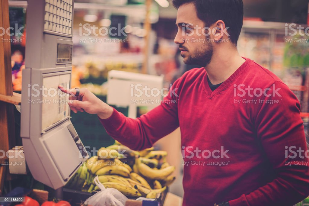 Beautiful handsome single man in shopping stock photo