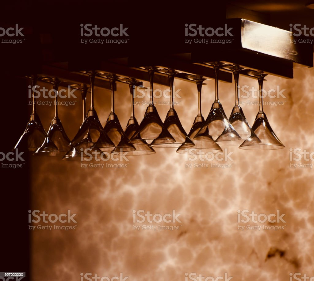 Beautiful hanging wine glasses in a bar stock photo