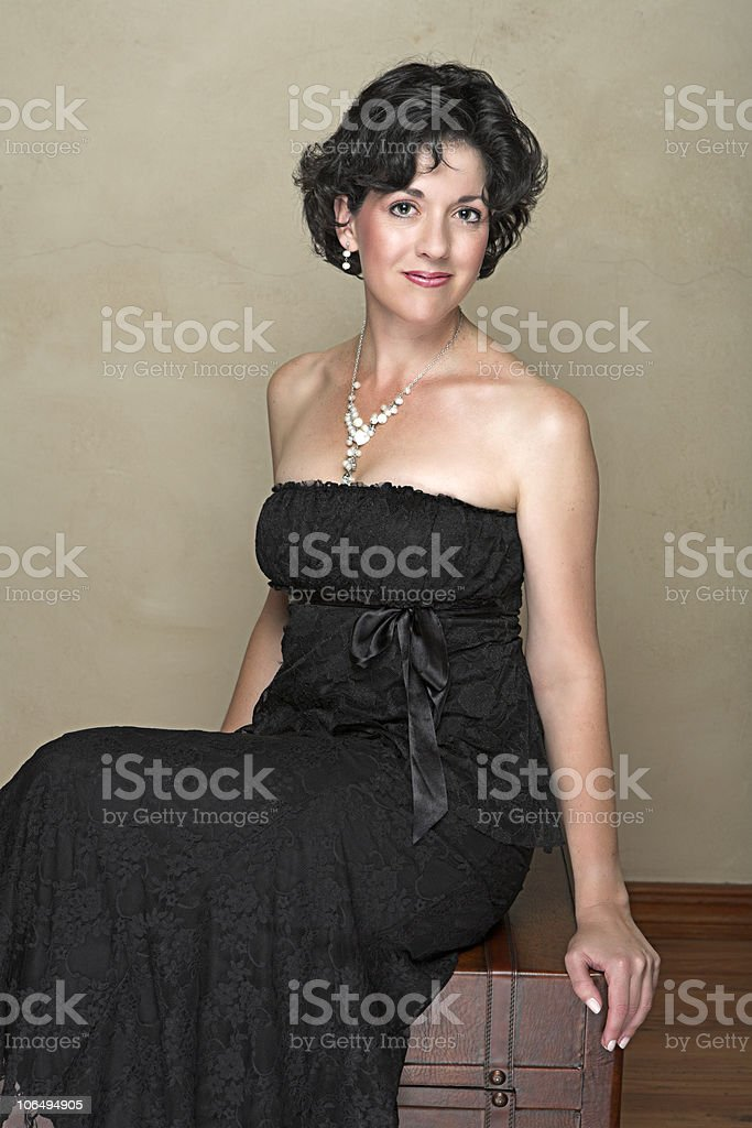Beautiful happy adult woman with black curly hair stock photo