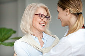 istock Beautiful happy aged woman embracing young adult daughter and laughing 924512804