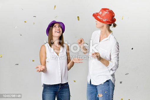 627933752istockphoto Beautiful happy and smiling girlfriends at the party. Dancing and celebrating time 1045298148