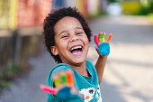 beautiful happy boy with painted hands, artistic, educational, fun concepts