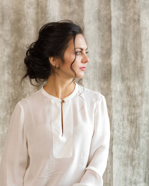 beautiful happy brunette woman in a white blouse portrait of a beautiful happy brunette woman in a white blouse blouse stock pictures, royalty-free photos & images